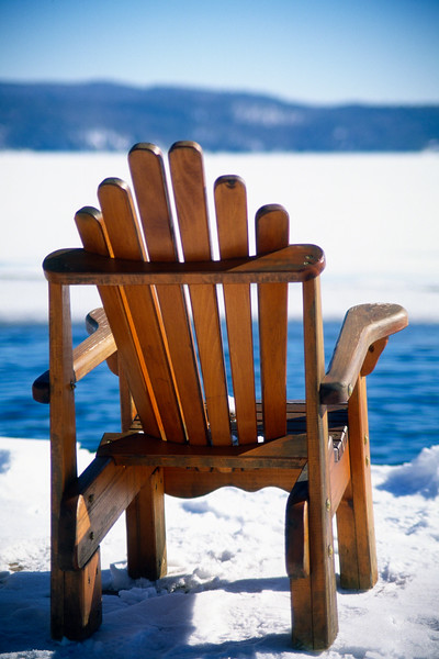 Empty Adirondack Chair on the Deck in Winter, Lake George, New York