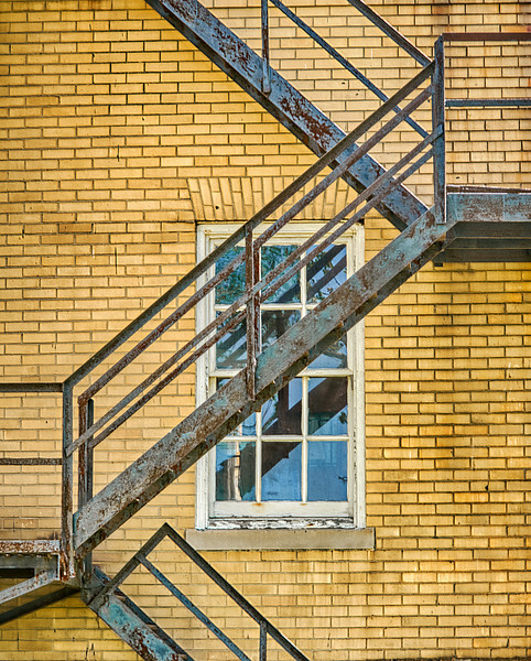 Fire Escape On Yellow Brick Wall