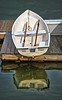 Resting Rowboat And Reflections