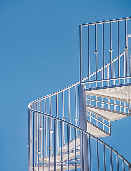 Spiral Staircase On Blue Sky