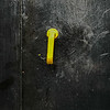 Yellow Handle On Black Engine Door