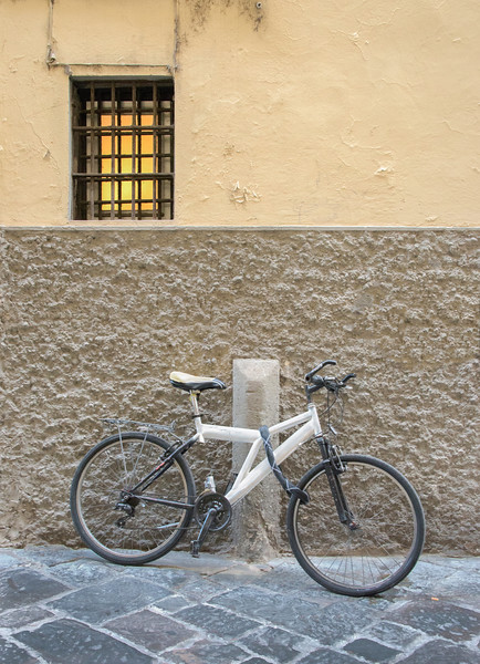 White Bicyclye Against Textured Wall