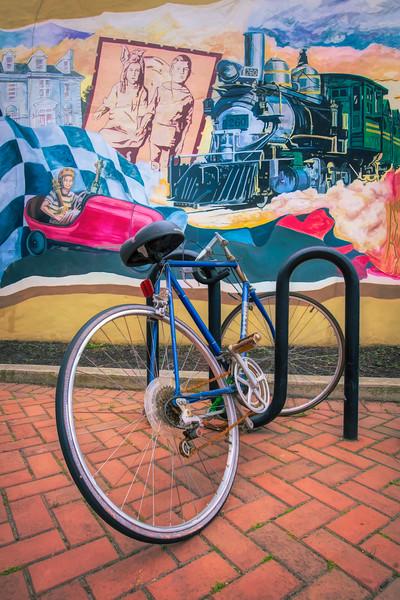 Bicycle In Rack Enjoying The Mural