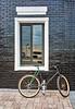 Black Bike Against Black Brick Wall