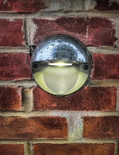 Eye Shaped Light On Brick Wall