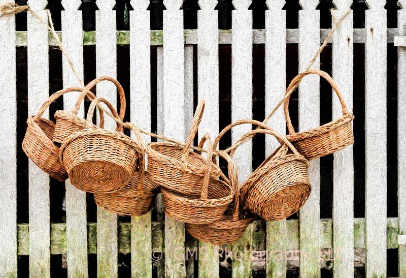 Baskets Hanging On Picket Fence