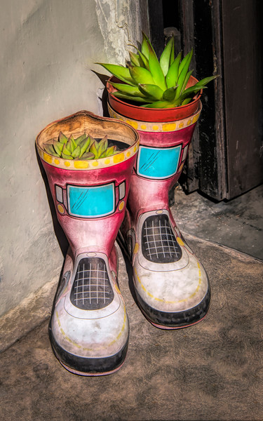 Planter Boots At Door In Florence Italy