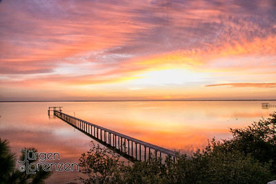 Sunrise with dock over St Joseph Bay