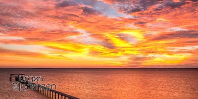 Sunrise over St Joseph Bay with dock