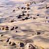 Sand Swirls and Smooth Pebbles