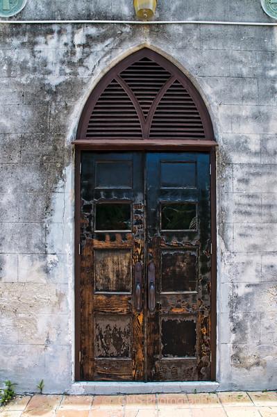 Weathered door at Saint Francis Xavier Cathedral in Nassau, Bahamas, July 2010