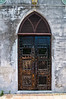 Weathered door at Saint Francis Xavier Cathedral in Nassau, Bahamas, July 2010