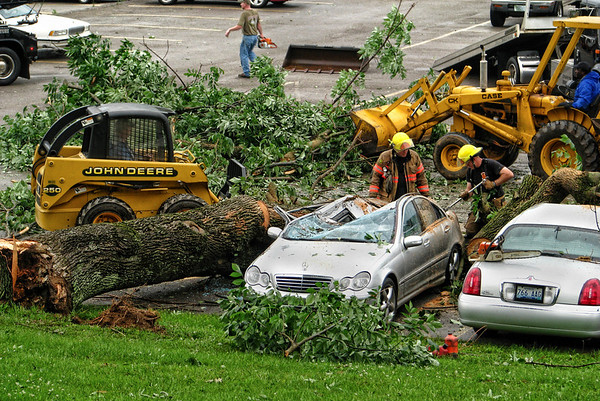 Tree downed onto car in TJ Sampson Parking lot after severe storms moved through Glasgow, KY.