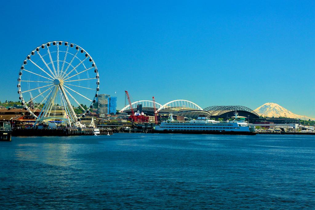 Seattle waterfront, sport stadiums, and Mount Rainier