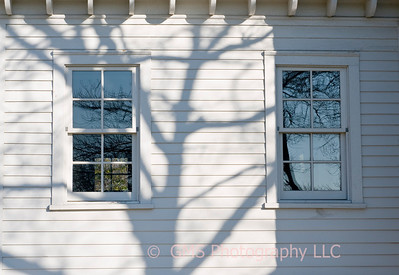 Early autumn shadows and reflections on windows of Sandy Hook Lighthouse in New Jersey