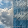 Reflection of Clouds In Building Window