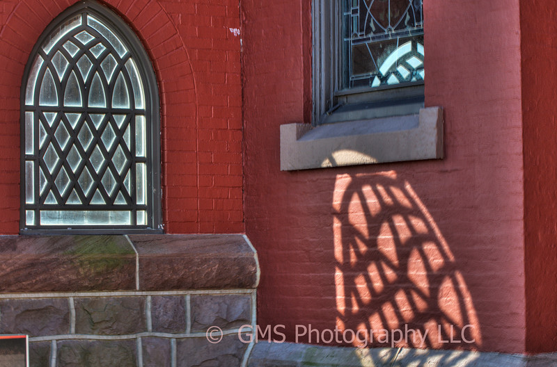 Window in entrance to church in Long Branch, New Jersey projects the light into two distinctly different patterns.