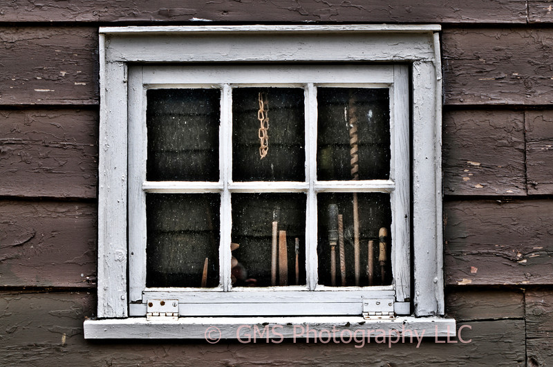 Tools are seen through the window at Historic Holmdel Park, Holmdel, New Jersey