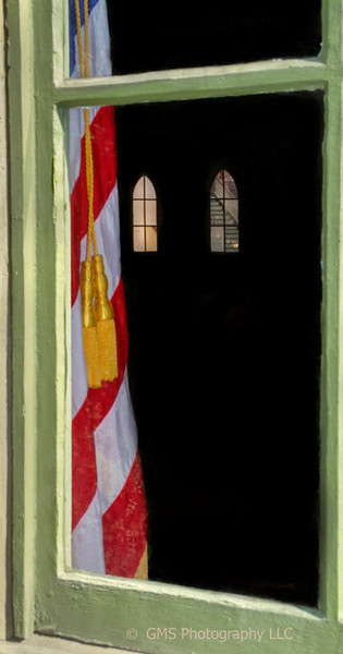 Flag is placed immediately inside window of meeting house adjacent to Great Auditorium in Ocean Grove, New Jersey.