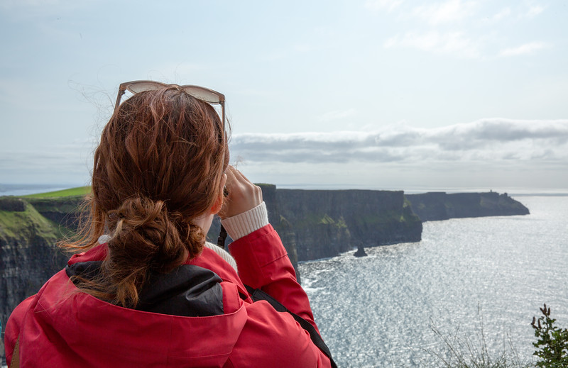 Girl Looking Out Over Cliffs