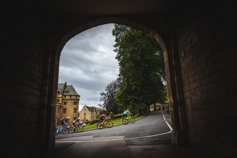 A group of riders though an archway at the Ryedale Grand Prix 2019