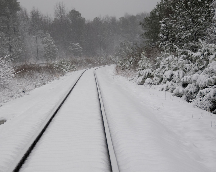 Snow covered train tracks