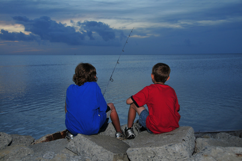 Boys fishing at sundown<br /> Outer Banks, NC