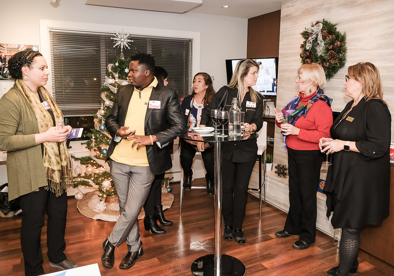 """About 25 guests dropped by during the evening to enjoy some """"Wine and Cheese"""" refreshments, and learn about what our Rotary Club is all about."""