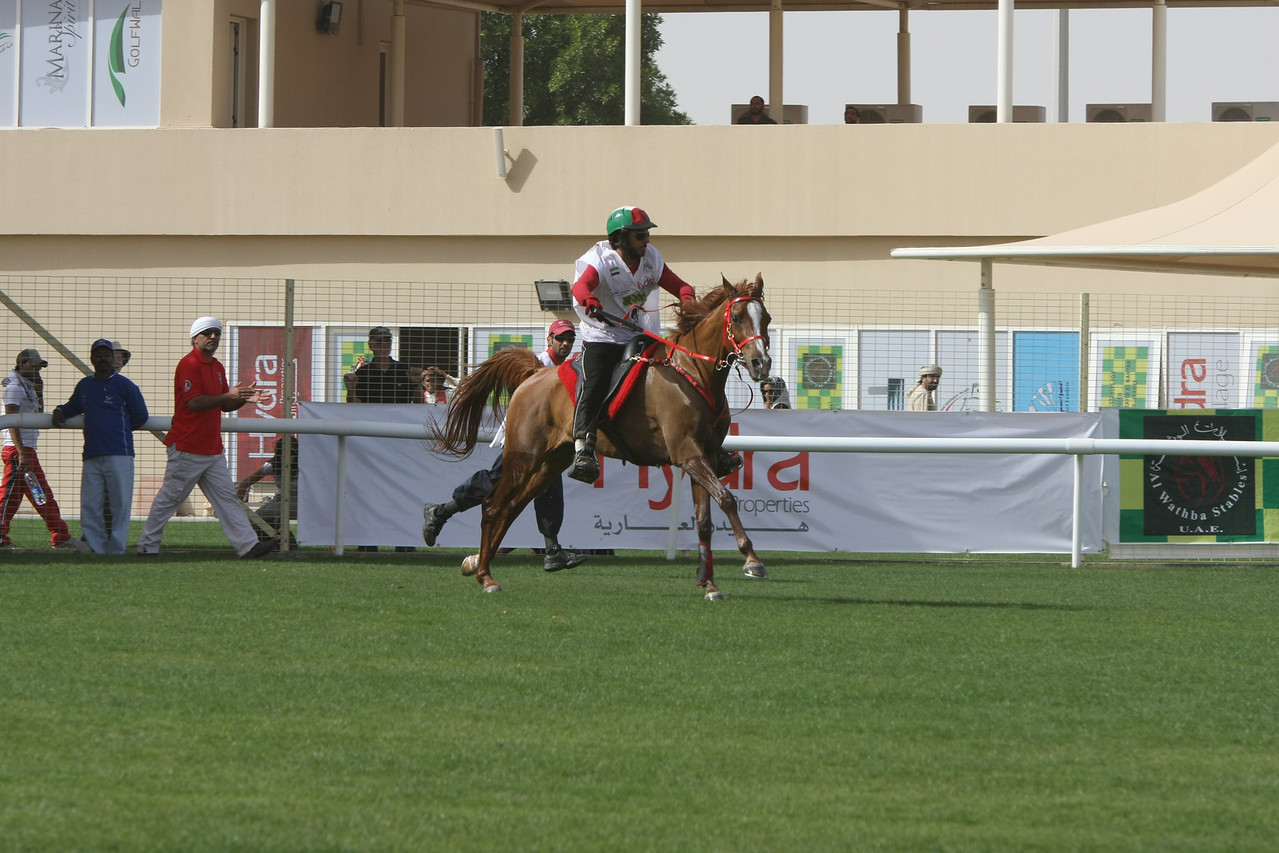 Omair Al Bloushi heads out to catch his cousin in first place.