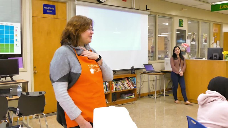 Maria Pollieri, Toronto team leader for the Toronto Chapter of Days for Girls provides an introduction of how today's sewing party will help girls stay in school and live a better life. CLICK CENTER ARROW TO VIEW VIDEO.