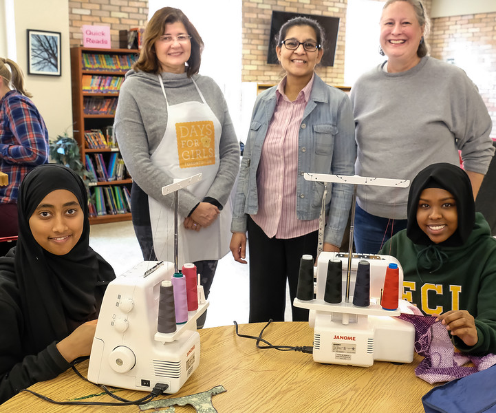 L-R Nuha, Maria P, Saira K, Elizabeth, and Ikram. Nuha and Ikrham were quick learners and soon mastered the process of serging the fabrics with these machines.