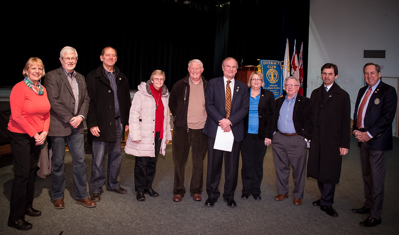 RTW President  Leighton Reid (5th from R) and 7070 District Governor Jim Louttit (far right)