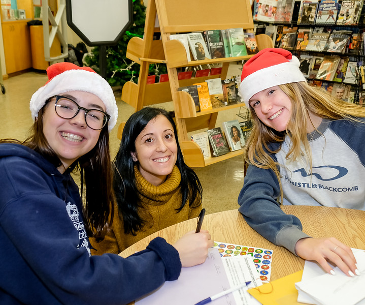 ECI teacher Ms Vink (centre) was very helpful in  organizing the letter writing event with Patti Wright, and coaching students as needed.