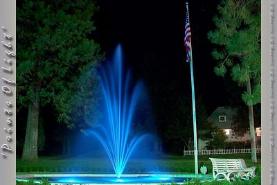 I was originally trying to get stars to show up behind the Flag this night.  I was not successful in that idea, but this fountain looked like it was shooting out blue flame with an exposure time of about 10 seconds.