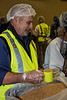 Rotarian Doug fills a measure cup  with nutritious ingredients.
