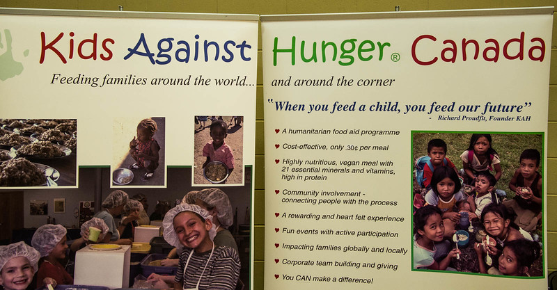 KAH Canada routinely gathers volunteers to assemble food packs to help eradicate hunger worldwide.