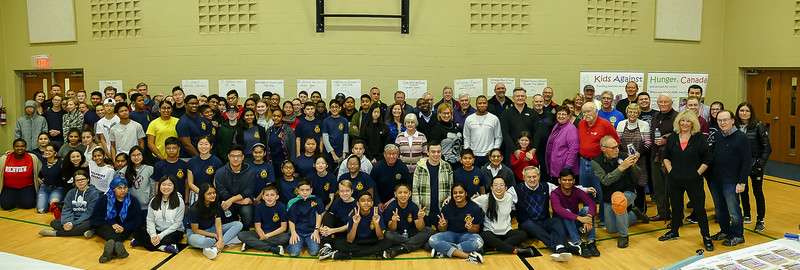 Group photo of ALL 150 + volunteers gathered together just before the two hour food packing assembly lines started.
