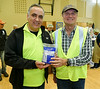 Rotary 7070 Assistant District Governor Iosif Ciosa (left) on hand to help out with RTW Past President Leighton Reid