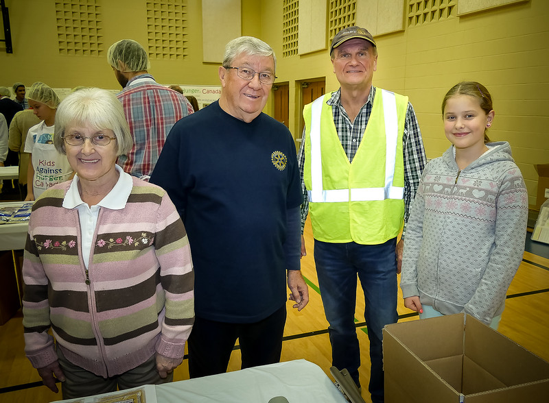 "Rotarians Linda, Terrry D (Pres RTW) and Leighton R (Past Pres RTW) with a very dedicated young  ""Kids Against Hunger Canada"" team organizer."