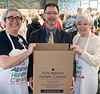 All bags are placed in a carton holding 36 packs.  Mary Lou Harrison, Neil Phillips and Donna Cansfield , each key District 7070 Rotary Directors, helped with assembly and final packing.