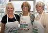 Etobicoke Rotarians  Samantha Dugas, Theresa Sherwood and Donna Cansfield (current President of Rotary  Etobicoke) all dressed and ready to assemble meal packs!