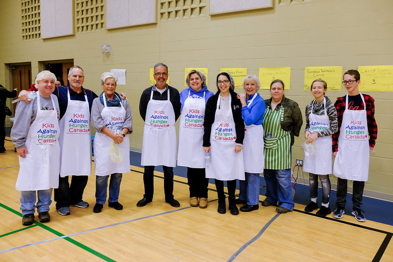 The lineup of volunteer members of the Etobicoke based Rotary Club of Toronto West.