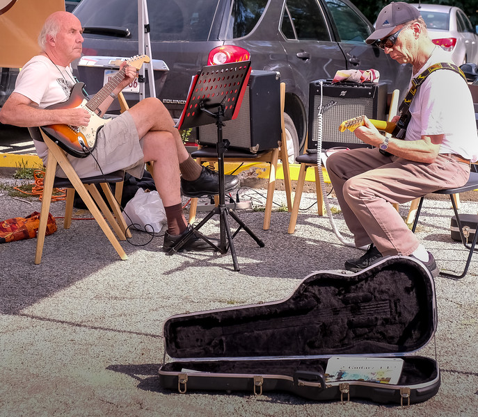 """Chris (left)  and John of """"2 Guitarz 4 U""""  drop by every few weeks to play some of the great Surf and Country hits from the 50's and 60's."""