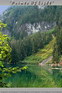 Don't adjust your monitor!  The lake here is named 'Greenlake', and it really is a deep emerald green!  The low brush across the lake grew over an avalanche scar in the forest, and is spectacular when fall colors come out!  On the northwest corner of Mount Rainier National Park, two miles above the Carbon River by trail.