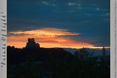 The final rays of the Sun illumining a 'Castle' at Sunset over Beacon Hill in Seattle, Washington.  It's not really a Castle... it used to be the old Mariner's Hospital, now it's the Corporate HQ for a DotCom.  Still, if it had a moat...