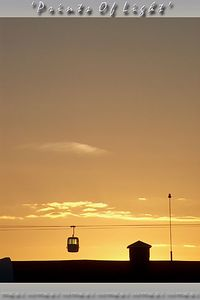 A vertical version of the Gondola at sunset... this one had no riders; what a waste!