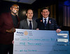 Tom Mihalik generously redirected his financial award towards 2 charities chosen by our club. Here Tom presents a cheque to the Youth Employment Services to YES President Tim Lang (C) and Mentor Kofi Amoama (L)