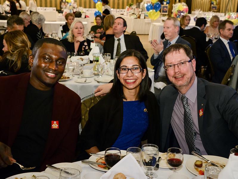 Kofi Amoama , Kaitlynn Almeida and District Governor Neil Phillips