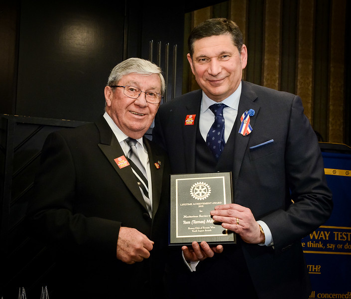 Tom accepts the Rotary Lifetime Achievement Award from RTW President Terry Donohue