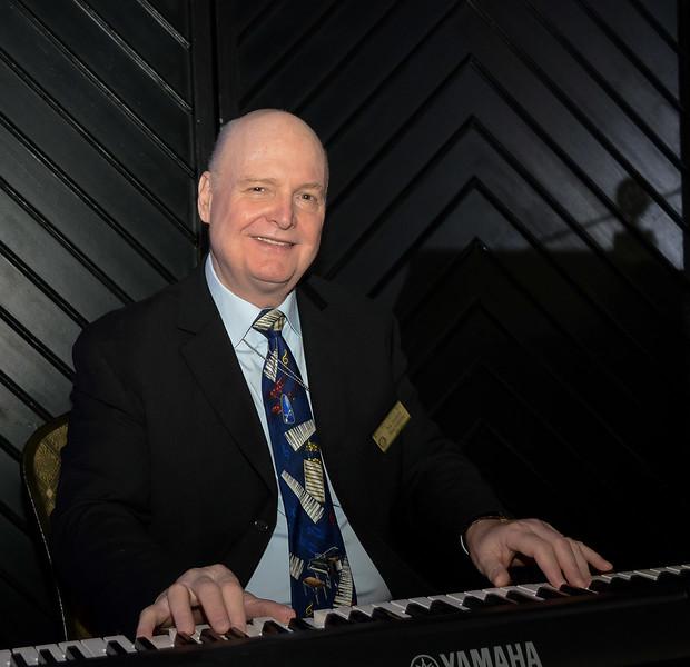 Rotarian Ron Manfield (RTW) - providing wonderful interlude music on the piano